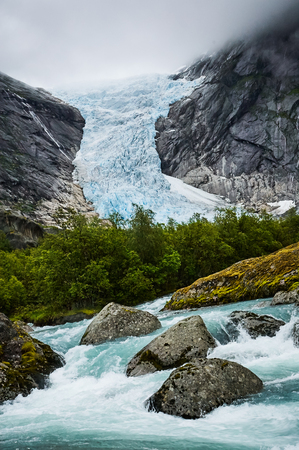 norwegian: Beautiful Norwegian landscape with glacier River and trees