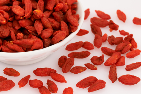 barbarum: Delicious red dried goji berries on white background