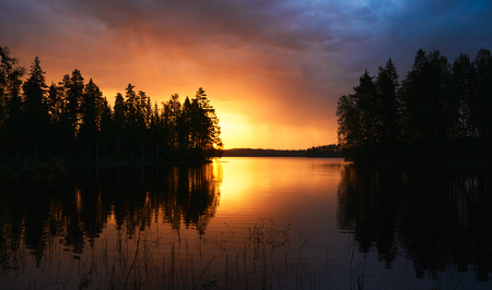 finnish: Finnish landscape at sunset with Lake, sky and trees