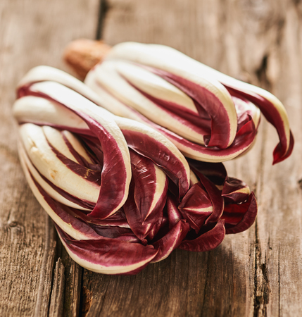 treviso: Italian red radicchio Treviso salad on an old table Stock Photo