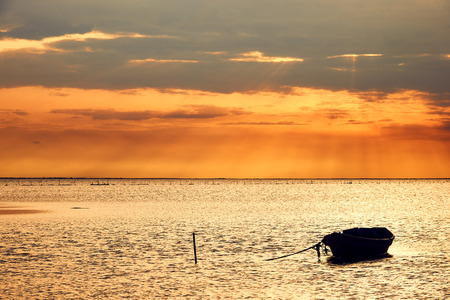 stillness: Beautiful seascape with a boat docked, photographed at dawn in the Camargue