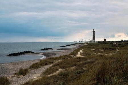The lighthouse Grenen (called Grey Tower) near Skagen (Denmark, North Jutland) at the junction of Skagerrak (North Sea) and Kattegat (Baltic Sea) Stock fotó
