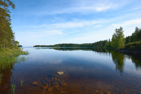 Beautiful Finnish Lake photographed in the bright Scandinavian summer Stock Photo