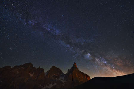Photography of a milky way on the beautiful Pala group (Italian: Pale di San Martino), in the Dolomites, Italy.