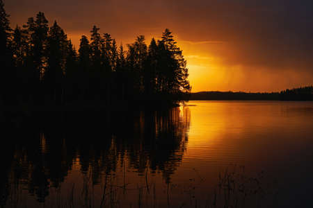 Finnish landscape at sunset with Lake, sky and trees