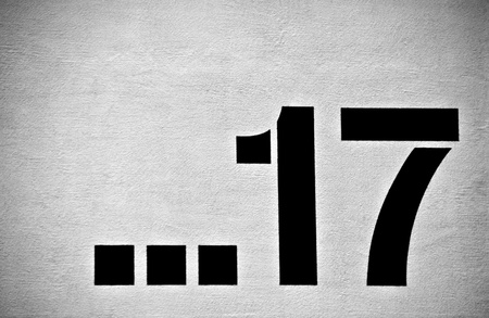 seventeen: a number on a urban wall in black and white Stock Photo