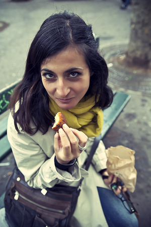 the madeleine: Girl eating a Madeleine, typical french cake Stock Photo