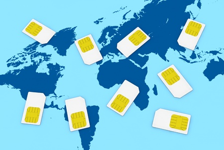 many sim cards with the world map on background (3d render) photo