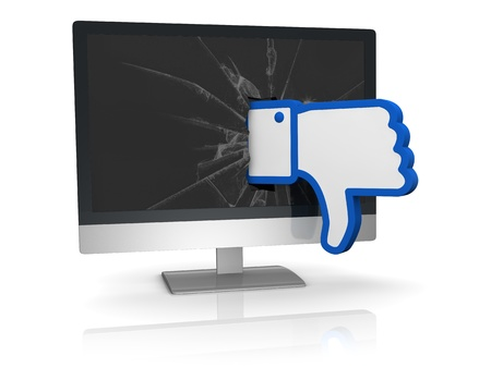 the thumbs down symbol of social networks that goes out from a computer screen (3d render) photo