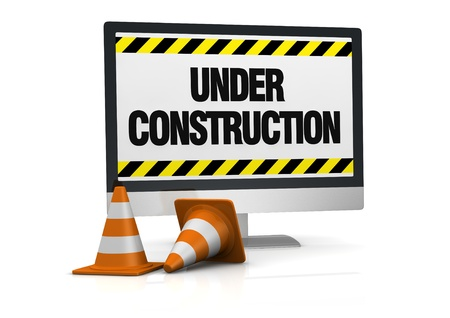 traffic cones and a computer with the words: under construction, on the display (3d render) Stock Photo - 11098033