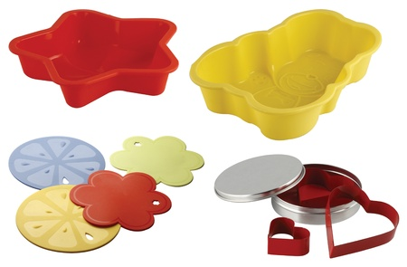 one set of four dessert mould in different shapes and colors photo
