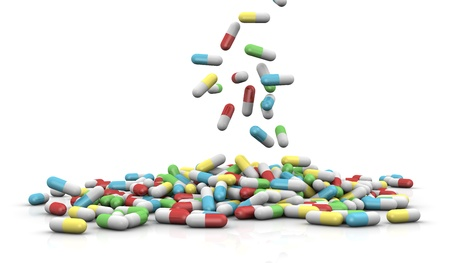 lot of pills in different colors that falls in the floor forming a pile (3d render)