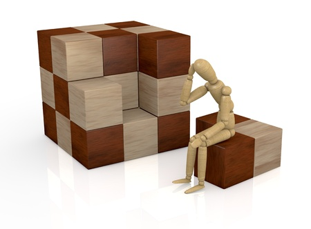 one wooden dummy that thinks how to solve a cube puzzle (3d render) photo