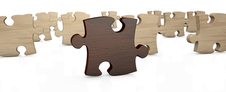 Several pieces of a puzzle with the one in front, in different color  3d render  photo