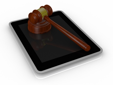 one tablet pc with a gavel, a concept of online auction or cyber crime (3d render) photo