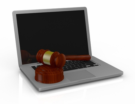 one pc notebook  with a gavel, a concept of online auction or cyber crime (3d render) photo