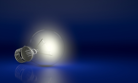 one light bulb on blue background (render 3d) photo