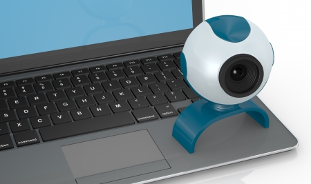 close up view of one computer notebook with a webcam (3d render) photo