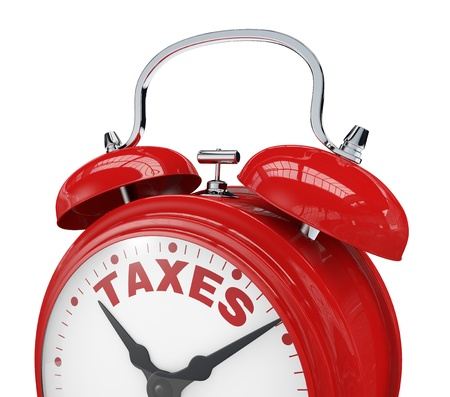 tax: close up view of a vintage alarm clock with the text  taxes instead of the numbers  3d render