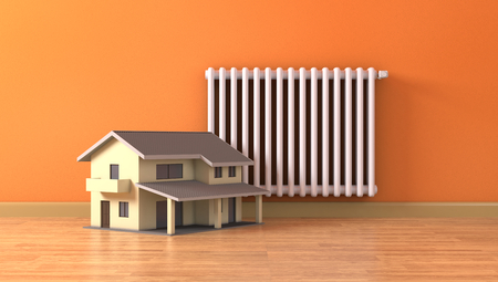 wood heating: one sunny room with a radiator and a small home, concept of house heating and comfort