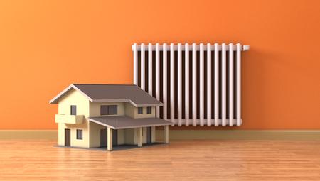 radiator: una habitación soleada con un radiador y una pequeña casa, concepto de calefacción de la casa y el confort