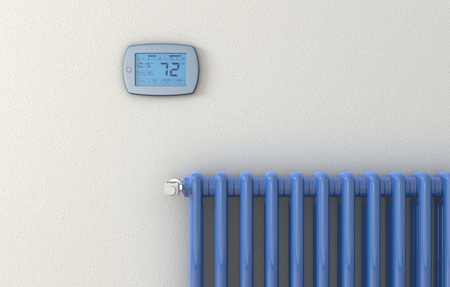 closeup of a digital thermostat panel and a radiator