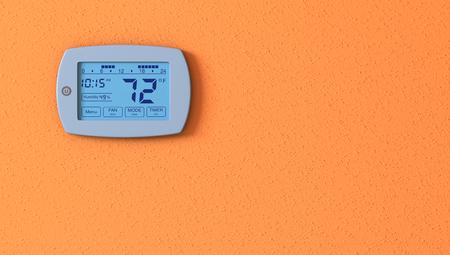 デジタル サーモスタット パネルで 1 つのオレンジの壁 写真素材