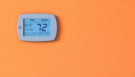 one orange wall with a digital thermostat panel
