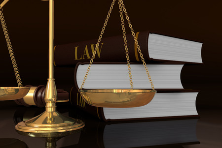 closeup of a weight balance and a stack of books, concept of law and justice  photo