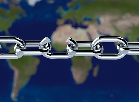 close-up of a metal chain with a broken link and a world map on background, concept of freedom (3d render) photo