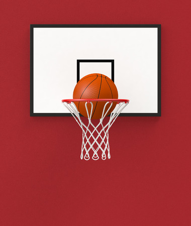 front view of a basketball hoop and a ball falling through the hoop (3d render) photo