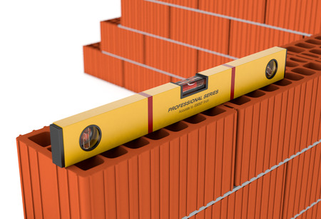 leveler: close up view of a brick wall and a spirit level (3d render)