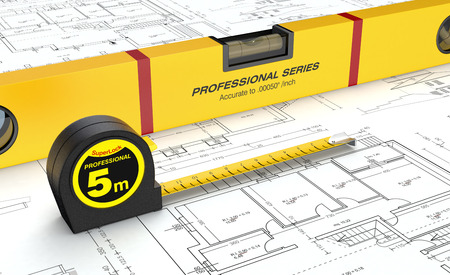 close up view of spirit level and a tape measure on a building blueprint (3d render)