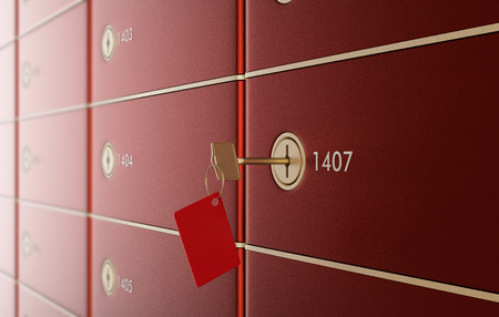 close up view of a stack of safe boxes, one of them with a key (3d render) photo