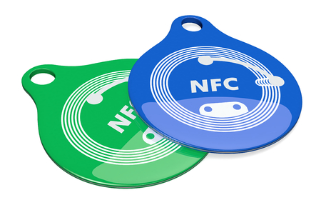 nfc: close up view of two nfc tags on white background (3d render)