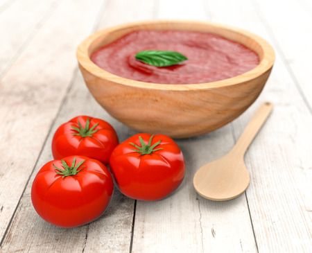 red tomatoes with a spoon and a bowl with tomato sauce, on wooden background (3d render) photo