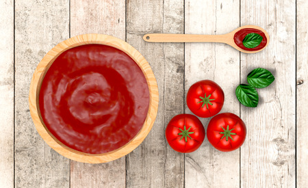 top view of red tomatoes, a spoon, a bowl with tomato sauce and basil leaves, on wooden background (3d render) photo