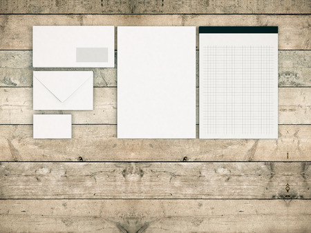 business space: top view of a business paper set with blank space and wood background (3d render)