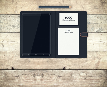 case: top view of a pc tablet with cover, paper notepad, a stack of business cards and a pencil (3d render)