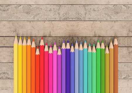 colour pencil: front view of a set of colored pencils on wooden background with blank space at the right (3d render) Stock Photo