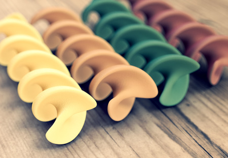 uncooked: closeup view of pasta in different colors (3d render)