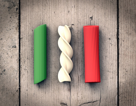 italian pasta: different shapes of pasta with the colors of the italian flag, wooden background (3d render)