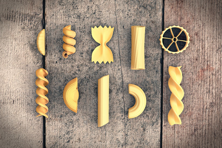 italian food: different shapes of pasta on wooden background (3d render)