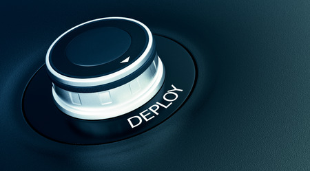 deploy: knob with arrow pointing to the word: deploy (3d render) Stock Photo