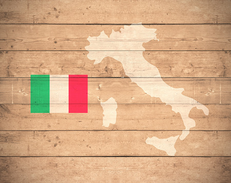 italy background: map of Italy with flag on wooden background (3d render) Stock Photo