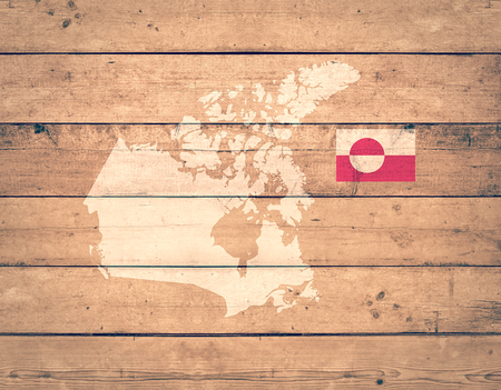 greenland: map of Greenland with flag on wooden background (3d render)