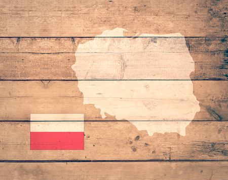 mapa europa: map of Poland with flag on wooden background (3d render)