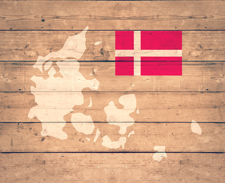 map of Denmark with flag on wooden background (3d render)