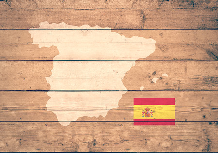 mapa europa: map of Spain with flag on wooden background (3d render)