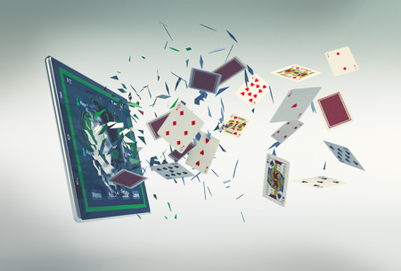 tablet pc with a poker app and lot of poker cards coming out by breaking the glass, concept of online gaming (3d render) Stockfoto